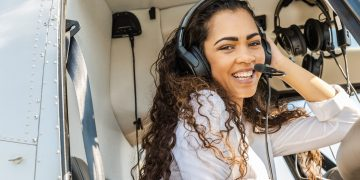 Young,Smiling,Woman,Helicopter,Pilot